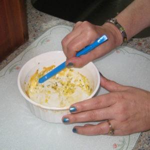 Scraping round Corningware dish
