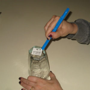 Scraping label of glass
