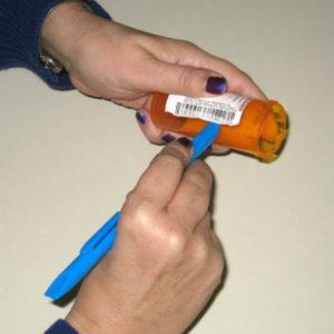 Scraping off prescription label