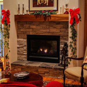 fireplace with logs burning