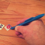 scraping sticker off wood floor